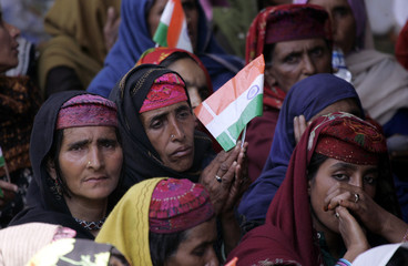 Kashmiri women hold Indian flags as they listen to Sonia Gandhi during a women's meet in Srinagar