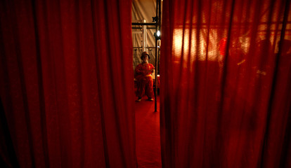 An Iranian comedian from the Tehran Great Circus waits to perform at a show in Tehran July 4, 2006...