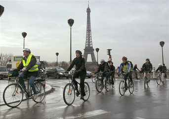 Paris commuters cycle to work during a continuing transport strike in France