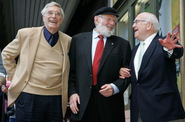 Actor Theodore Bikel is hugged by Martin Landau and Ed Asner after receiving star on Hollywood Walk of Fame.