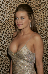 Actress Carmen Electra poses for photographers at the opening of the Roberto Cavalli Boutique in ...