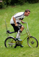 German national soccer team players Podolski rides a Bonanza bicycle during a break in filming TV commercial for Adidas and the DFB in Lerbach