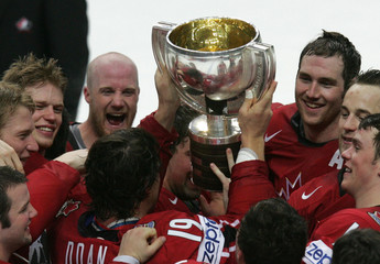 Players of the Canadian team hold the trophy after winning the Ice Hockey World Championship final against Finland in Moscow