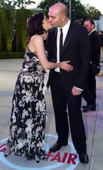 ACTRESS SELMA BLAIR KISSES AHMET ZAPPA AT THE VANITY FAIR OSCAR PARTY.