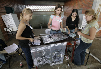 Paraguayan election officials count ballots after the polls closed in Asuncion