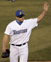 Trenton Thunder pitcher Roger Clemens waves to the crowd in the sixth inning while leaving the Thunder versus the Portland Sea Dogs Eastern minor league baseball game in Trenton New Jersey