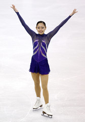 Ando of Japan acknowledges the crowd during the Ladies Free Skating portion of the 2009 ISU World Figure Skating Championships in Los Angeles