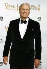 NBC newscaster Tom Brokaw poses backstage at Golden Globes