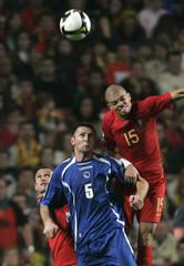 Portugal's Pepe challenges Bosnia's Elvir Rahimic during their World Cup 2010 playoff qualifying soccer match in Lisbon
