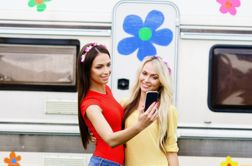Attractive, beautiful, young girls taking selfie outdoors. Holiday, vacation, hobby concept.