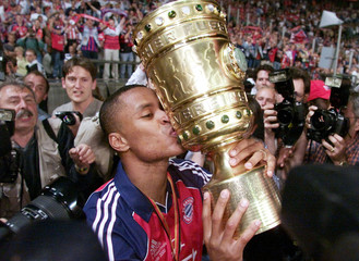 Bayern Munich's Brazilian Paulo Sergio kisses the cup after the German soccer cup final  [against We..