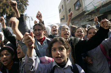 Palestinian school girls shout slogans during the funeral of 13-year-old Palestinian girl in Tulkarm