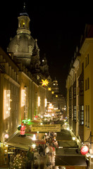 People visit a Christmas market near the Frauenkirche in downtown Dresden