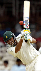 Pakistan's Younis khan plays a shot on the second day of third test match in Bangalore.