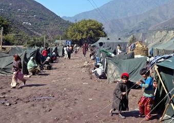 Kashmiri earthquake survivors sit outside their tents in Kalgai, 120 km (75 miles) west of Srinagar ..
