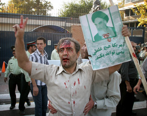Iranian protestor shouts slogans in support of Iran's nuclear technology during a protest gathering in Tehran
