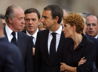 Spanish King Juan Carlos Spanish Prime Minister Zapatero and wife Espinosa leave Valencia's cathedral after attending a funeral service in Valencia