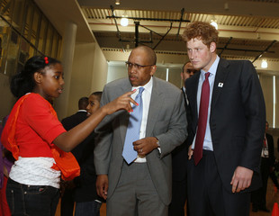 Britain's Prince Harry and Prince Seeiso of Lesotho talk to a student during a tour of the Harlem Children's Zone school in the Harlem region of New York