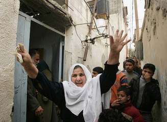 A Palestinian woman shouts during the funeral of Shamiya in the southern Gaza Strip