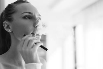Black-white photo of smoking girl