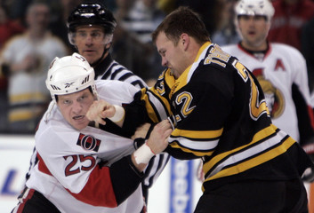 Boston Bruins Shawn Thornton fights with Ottawa Senators Chris Neil in first period action during their NHL hockey game in Boston