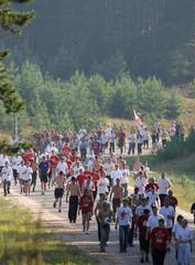 Members of pro-Putin youth movement Nashi run during cross-country race near Lake Seliger.