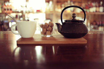 teapot and cup of tea at a cafe