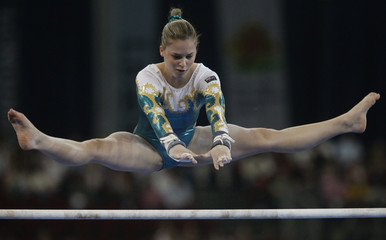 Dykes of Australia performs her routine on uneven bars during World Artistic Gymnastics Championships in Stuttgart