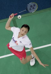 China's Ning eyes the shuttlecock during her women's singles match against South Korea's Soo Young at the World Badminton Championships in Kuala Lumpur