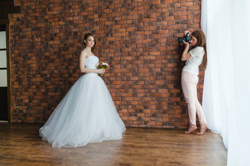 Photographer is taking pictures the bride