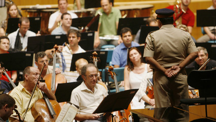A policeman speaks to members of the Israel Philharmonic Orchestra regarding their security during rehearsals in Mumbai