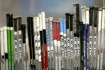 Hockey sticks are lined up on the Czech Repulic's bench during their men's ice hockey game against [..