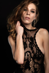 close up portrait of sexy brunette with long hair that keeps black lace jacket without lingerie