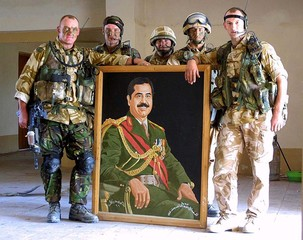 BRITISH 7TH ARMOURED DESERT RATS POSE WITH PICTURE OF SADDAM HUSSEIN ONOUTSKIRTS OF BASRA.