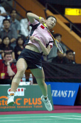 CHINA'S ZHANG NING SMASHES THE SHUTTLE COCK DURING THE FINAL MATCH OF UBER CUP IN JAKARTA.