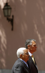 Cape Verde's President Pires is accompanied by Portugal's President Silva as they listen to national anthems in Lisbon