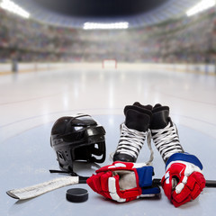 Hockey Equipment on Ice of Crowded Arena