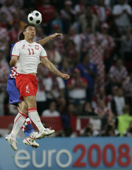 Croatia's Dario Knezevic challenges Poland's Marek Saganowski during their Group B Euro 2008 soccer match at the Woerthersee Stadium in Klagenfurt