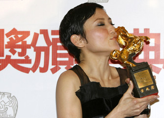 "Prudence Liew poses with her best leading actress award for ""True Woman For Sale"" at the 45th Golden Horse Awards in Taichung"