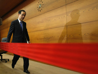 Bank of Japan Governor Masaaki Shirakawa leaves a room after a news conference at the bank in Tokyo