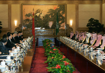 King Abdullah of Saudi Arabia attends a welcoming ceremony with Chinese President Hu at the Great Hall of the People in Beijing
