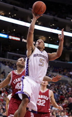 Washington's Will Conroy goes up for a basket past Stanford's Little and Haas during the 2005 PAC-10 ...