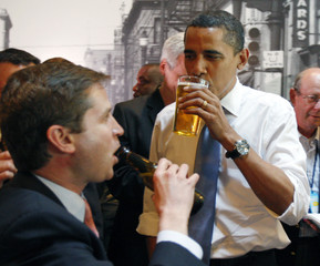 U.S. Presidential candidate Obama drinks a beer at a bar in Raleigh