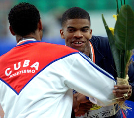 USA'S TRAMMELL IS CONGRATULATED BY CUBAN GARCIA AT WORLD INDOOR ATHLETICS CHAMPIONSHIPS.