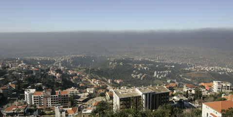 Smoke from burning tyres rises above Beirut in this picture shot from Mount Lebanon