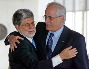 Brazil's Foreign Minister Amorim hugs his Argentine counterpart Taiana in Brasilia