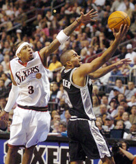 SPURS PARKER HEADS FOR THE BASKET AS 76ERS IVERSON DEFENDS.