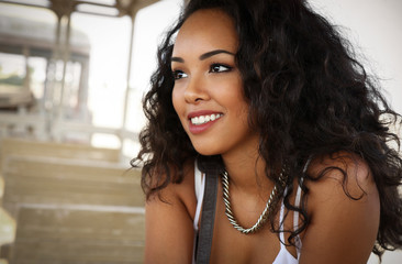 Beautiful young girl face portrait, curly hair and nice smile, fashion model look, vintage train scenery