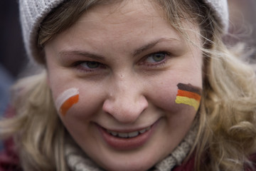 A girl attends the celebrations at a former no-go zone that cuts across one of Europe's most beautiful beaches into the Baltic Sea at German-Polish border checkpoint Ahlbeck-Swinemuende