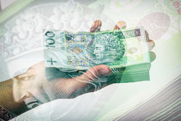 stack of polish banknotes in hand